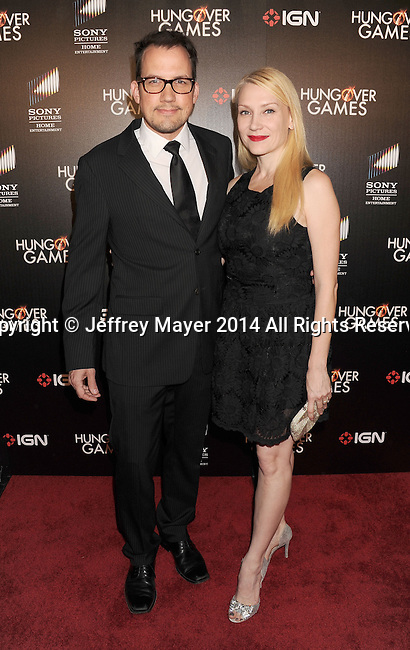 HOLLYWOOD, CA- FEBRUARY 11: Actors John Livingston; Jenni Blong attend the Los Angeles Premiere of 'The Hungover Games' at TCL Chinese Theatre on February 11, 2014 in Hollywood, California.