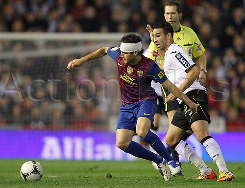 01.02.2012. Valencia, Spain. Cesc Fabregas in action during  semi-final Copa del Rey, first leg, match between Valencia against FC Barcelona at Mestalla stadium