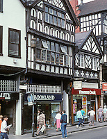 Chester: Buildings on Bridge Street. The building in center is 1664. The one to the right of it is real. The one to the far right is fake.