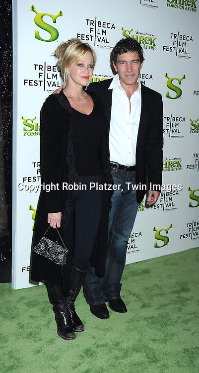 """Melanie Griffith and Antonio Banderas arriving at The """"Shrek Forever After"""" world premiere at The opening night of The Tribeca Film Festival on April 21, 2010 at The Ziegfeld Theatre in New York City. The movie stars Cameron Diaz, Mike Meyers, Eddie Murphy and Antonio Banderas."""