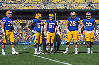 The Pitt Panthers offensive line. Pictured are Brian O'Neill (70); Alex Officer (63), Jimmy Morrissey(67), Alex Bookser (78) and Jaryd Jones-Smith (55).The North Carolina Wolfpack defeated the Pitt Panthers 35-17 at Heinz Field, Pittsburgh, PA on October 14, 2017.