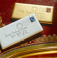 A pair of matching cigarette cases in the form of stamped envelopes addressed to the Duke and Duchess of Windsor