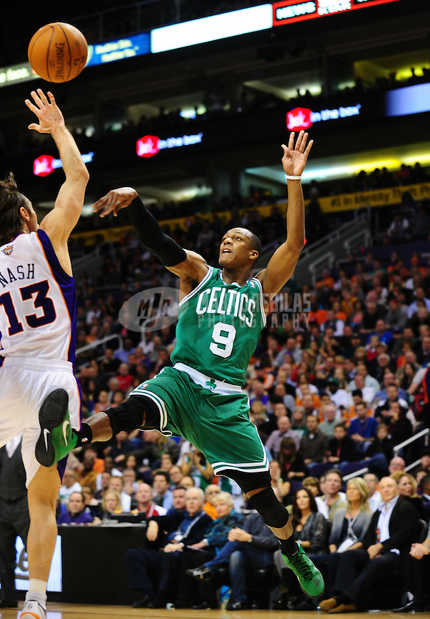 Jan. 28, 2011; Phoenix, AZ, USA; Boston Celtics guard Rajon Rondo (9) puts up a shot against the Phoenix Suns guard Steve Nash (13) at the US Airways Center. Mandatory Credit: Mark J. Rebilas-