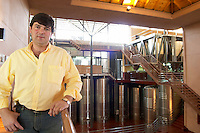 The winemaker Leonardo Puppato in the winery, stainless steel tanks in the background. Bodega Familia Schroeder Winery, also called Saurus, Neuquen, Patagonia, Argentina, South America