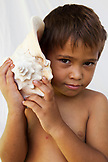 FRENCH POLYNESIA, Moorea. Portrait of Dushan holding a seashell.
