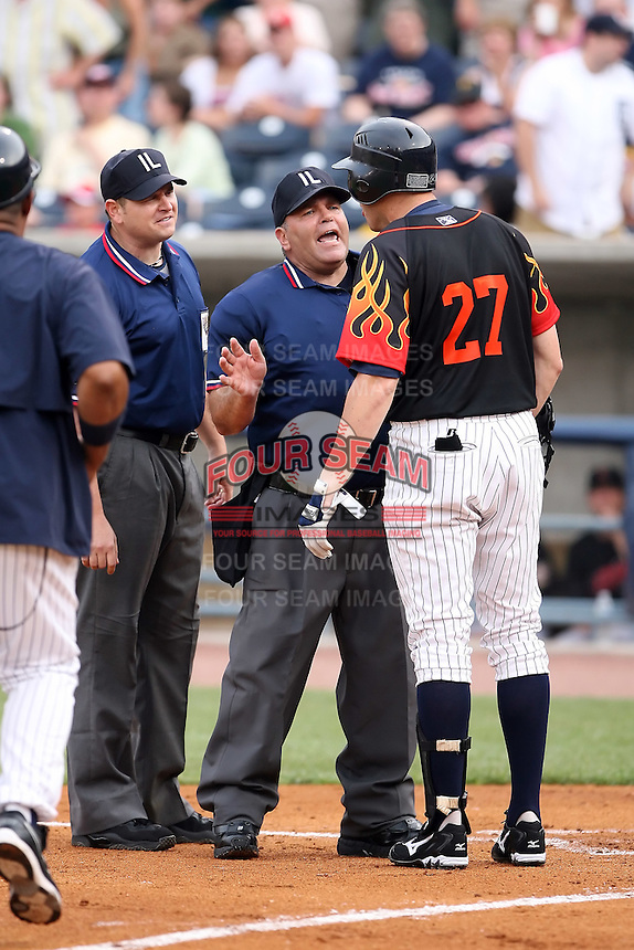 June 12th 2008:  Home plate umpire Larry Bialoroucki steps in between Mike Hessman of the Toledo Mudhens, Class-AAA affiliate of the Detroit Tigers, and first base umpire Kevin Causey during a game at Fifth Third Field in Toledo, OH.  Causey ejected Hessman after hitting a home run.  Photo by:  Mike Janes/Four Seam Images