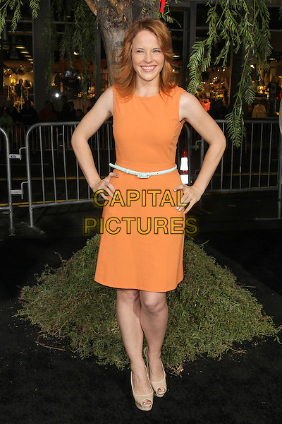 """Katie Leclerc.""""Beautiful Creatures"""" Los Angeles Premiere held at the TCL Chinese Theatre, Hollywood, California, USA. .February 6th, 2013.full length dress hands on hips orange sleeveless green belt .CAP/CEL .©CelPh/Capital Pictures."""