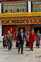 Tibetan pilgrims circumambulating Barkhor Square and The Barkhor, Lhasa, Tibet (Xizang), China.