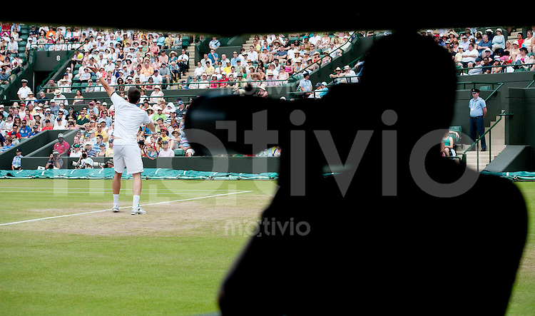 Photographers watch a match on Court 1. The Wimbledon Championships 2010 The All England Lawn Tennis & Croquet Club  Day 6 Saturday 26/06/2010