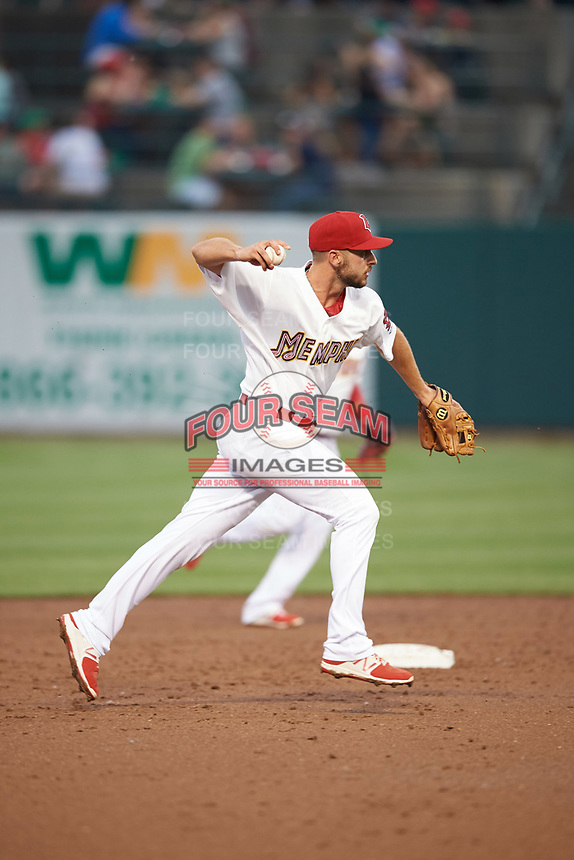 Memphis Redbirds shortstop Paul DeJong (11) throws to first base during a game against the Round Rock Express on April 28, 2017 at AutoZone Park in Memphis, Tennessee.  Memphis defeated Round Rock 9-1.  (Mike Janes/Four Seam Images)
