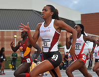 NWA Media/Michael Woods --05/29/2014-- w @NWAMICHAELW...University of Arkansas runner Taylor Ellis Watson heads down the home stretch in the women's 400 meter preliminaries Thursday afternoon at the 2014 NCAA Division 1 Track and Field West Preliminary track meet at John McDonnell Field in Fayetteville.
