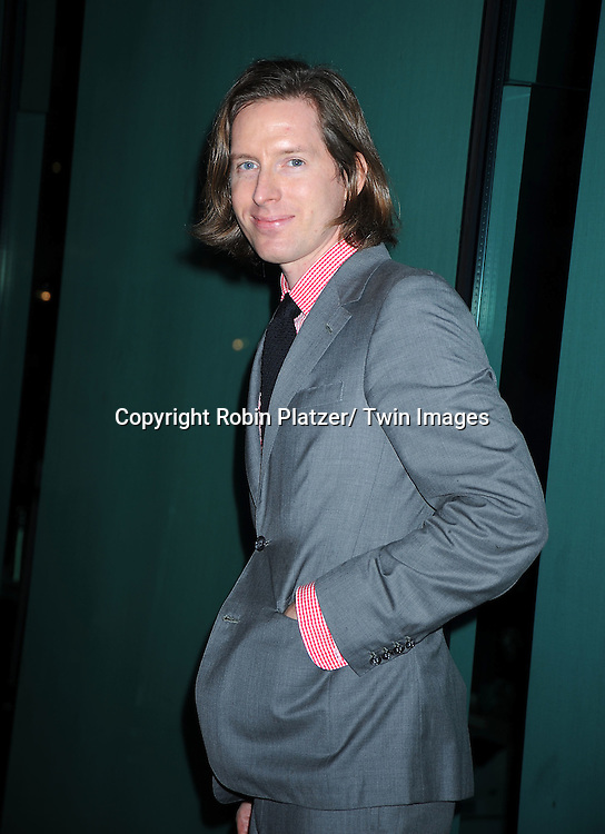 "Wes Anderson posing for photographers at the Opening Night of The New York Film Festival world premiere of ""The Social Network"" on September24, 2010 at Alice Tully Hall in New York City."