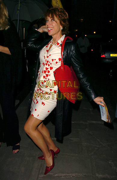 "KATHY LETTE.After Party for the  UK Film Premiere of ""Wah Wah"", .Sketch, London, England, .May 30th 2006..full length red and white dress bag funny pose hearts  heart print pattern shaped.Ref: CAN.www.capitalpictures.com.sales@capitalpictures.com.©Can Nguyen/Capital Pictures"