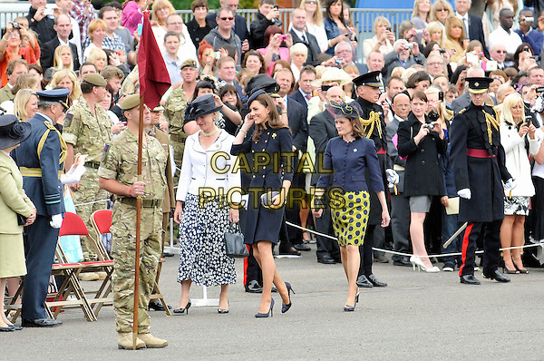 Catherine, Duchess of Cambridge .Prince William, Duke of Cambridge and Catherine, Duchess of Cambridge present Afghanistan campaign medals to the 1st Battalion Irish Guards, Victoria Barracks, Windsor, Berkshire .England, UK, 25th June 2011..full length coat uniform military   Kate Middleton princess black hat  gold brass buttons clutch bag shoes smiling  royal .CAP/CAS.©Bob Cass/Capital Pictures.