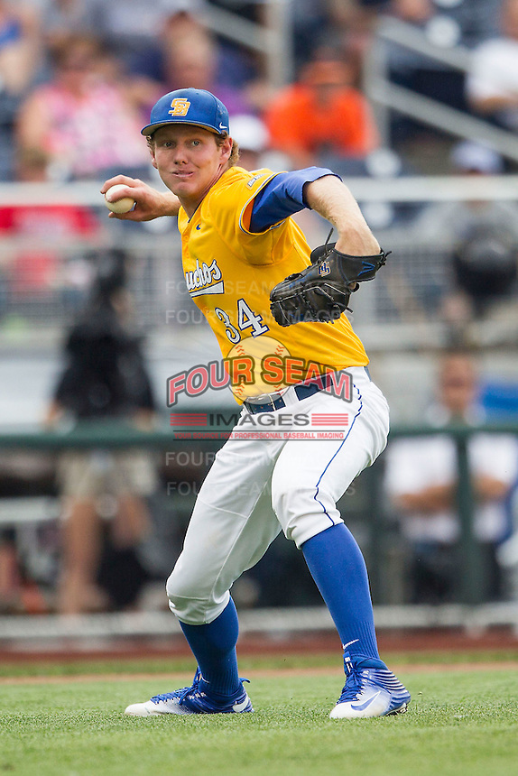UC Santa Barbara Gauchos pitcher Noah Davis (34) makes a throw to first base against the Miami Hurricanes in Game 5 of the NCAA College World Series on June 20, 2016 at TD Ameritrade Park in Omaha, Nebraska. UC Santa Barbara defeated Miami  5-3. (Andrew Woolley/Four Seam Images)