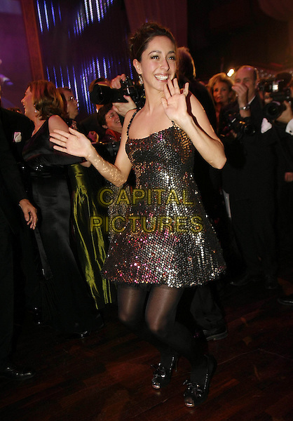 OONA CHAPLIN .The Opera Ball, Frankfurt, Germany..March 1st, 2009.full length black tights gold sequins sequined dress hands dancing gesture.CAP/PPG/TF.©T. Furthmayr/People Picture/Capital Pictures