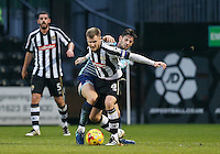 Michael O'Connor of Notts Co battles Joe Jacobson of Wycombe Wanderers during the Sky Bet League 2 match between Notts County and Wycombe Wanderers at Meadow Lane, Nottingham, England on 10 December 2016. Photo by Andy Rowland.