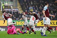 Burnley's Jack Cork scoring his side's first goal under pressure from Liverpool's Naby Keita<br />