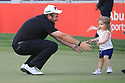 Shane Lowry (IRL) and his daughter during the final round of the Abu Dhabi HSBC Championship presented by EGA played at Abu Dhabi Golf Club, Abu Dhabi, UAE. 17/01/2019<br /> Picture: Golffile | Phil Inglis<br /> <br /> All photo usage must carry mandatory copyright credit (© Golffile | Phil Inglis)