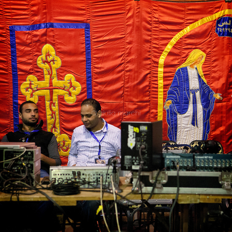 Egypt / Cairo / 18.11.2012 / Press technician  in St Mark Cathedral in Abbasseya when Theodoros II or Tawadros II was formally enthroned on November 18, 2012 as the 118th pope. © Giulia Marchi