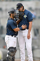 Starting pitcher David Peterson (30) of the Columbia Fireflies talks with catcher Scott Manea on the mound in a game against the Greenville Drive on Sunday, May 27, 2018, at Spirit Communications Park in Columbia, South Carolina. Greenville won, 3-0. (Tom Priddy/Four Seam Images)