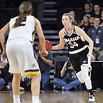 SIOUX FALLS, SD - MARCH 7:  Ellie Brecht #34 of  Omaha dribbles up court met by Macy Miller #12 of South Dakota State during the 2016 Summit League Tournament. (Photo by Dick Carlson/Inertia)