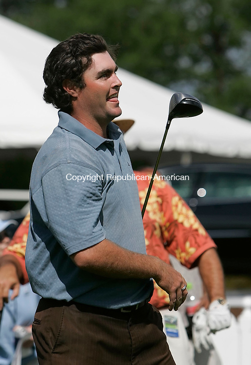 CROMWELL, CT 23 AUGUST 2005 082305BZ05- PGA Tour pro Steven Bowditch reacts after hitting a drive as a pinch hitter for ESPN personality Chris Berman after Berman faked an injury to bring in a ringer  <br /> during the Buick Championship Long Drive Contest at the TPC at River Highllands Tuesday afternoon. Bowditch drove the balll more than 330 yards.<br /> Jamison C. Bazinet / Republican-American