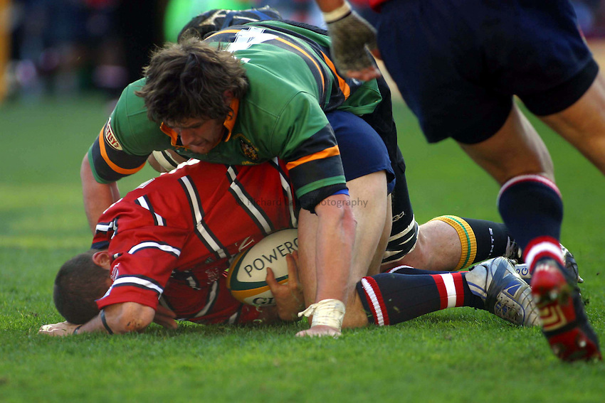 Photo. Jo Caird.Gloucester v Northampton Saints. Powergen Cup Final. 05/04/2003.Henry Paul is tackled by Matt Lord