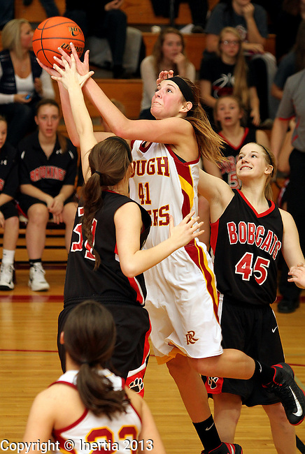 SIOUX FALLS, SD - FEBRUARY 25:  Tagyn Larson #41 from Roosevelt shoots past the double team of Amelia Miller #31 and Margaret Chell #45 from Brookings in the first half of their District 1AA game Monday night at Roosevelt. (Photo by Dave Eggen/Inertia)