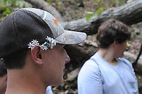 NWA Democrat-Gazette/FLIP PUTTHOFF <br /> Wildflowers make a souvenir    Oct. 7, 2015   for a student during the field trip.