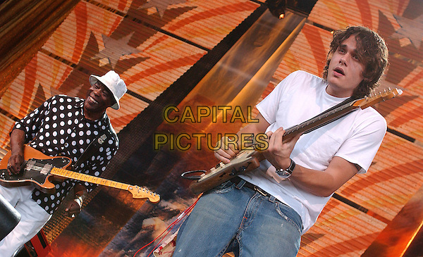 BUDDY GUY & JOHN MAYER .20th Anniversary FARM AID 2005 held at the Tweeter Center, Tinley Park, IL, USA..September 18th, 2005.Photo by Jason Nelson/AdMedia/Capital Pictures.Ref: JN/CAP.half length stage concert gig performance guitar.www.capitalpictures.com.sales@capitalpictures.com.© Capital Pictures.