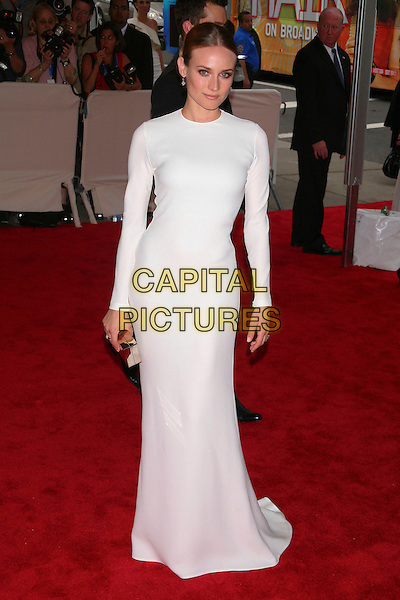 """DIANE KRUGER .attending the Metropolitan Museum of Art's Costume Institute Gala """"American Woman: Fashioning A National Identity"""" held at the Metropolitan Museum of Art, New York, NY, USA, May 3rd, 2010..arrivals full length white long maxi dress sleeves sleeve round scoop neck clutch bag gold box  silver                                                      CAP/LNC/TOM.©LNC/Capital Pictures."""