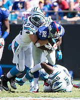 The Carolina Panthers played the New York Giants at Bank of America Stadium in Charlotte, NC.  The Panthers won 38-0 for their first victory of the season.  The Giants dropped to 0-3.  New York Giants running back David Wilson (22), Carolina Panthers middle linebacker Chase Blackburn (93)