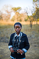 "15 year old Gweni Mwanabene, from Kafinda basic school in Sereje district, on her first safari in Kasanka National Park. ""Some parents think that National Parks are there because the people are involved in protecting animals are somehow selfish and don't want to share the animals in terms of meat with the others outside the national parks. If people kill the animals in the NP there won't be any left. It stops our country's development because animals are a source of tourist attractions."" Local schools and women's groups are regularly brought into Kasanka, which is unique in the country and unusual in Africa as it is privately managed and owned by a trust. People are able to see animals flourishing in land which was once free reign for poachers. Combined with anti-poaching scouts, the education programme is on the frontline of conservation methods in the park, showing local people wild animals in their natural habitat."