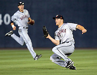 Virginia outfielder Joe McCarthy (31) makes a sliding catch during an NCAA college baseball regional tournament game against Arkansas in Charlottesville, VA., Friday, June 1, 2014. Virginia won 9-2. (AP Photo/Andrew Shurtleff)