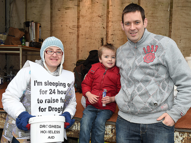 Dave and Ryan Campbell gives a donation to Nicola Durnin who is taking part in the 24 hour sleep out to raise funds for Drogheda Homeless aid. Photo:Colin Bell/pressphotos.ie