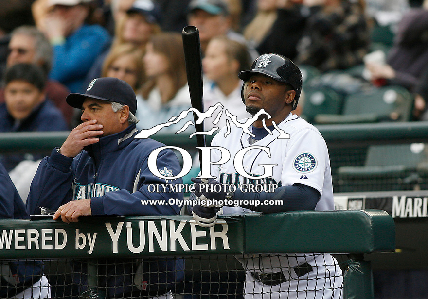 12 April 2010: Seattle Mariners designated hitter #24 Ken Griffey Jr. looks over his bat while standing on the top step of the dugout against the Oakland A's.  Oakland won 4-0 over Seattle at Safeco Field in Seattle, Washington.