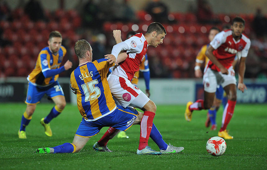 Fleetwood Town's Jamie Proctor is tackled by Shrewsbury Town's Mark Ellis<br /> <br /> Photographer Dave Howarth/CameraSport<br /> <br /> Football - Johnstone's Paint Trophy Northern Section Second Round - Fleetwood Town v Shrewsbury Town - Tuesday 6th October 2015 - Highbury Stadium - Fleetwood<br />  <br /> &copy; CameraSport - 43 Linden Ave. Countesthorpe. Leicester. England. LE8 5PG - Tel: +44 (0) 116 277 4147 - admin@camerasport.com - www.camerasport.com