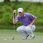 Jimmy Walker in action on the thirteenth green during the CIMB Asia Pacific Classic 2011.  Photo © Andy Jones / PSI for Carbon Worldwide