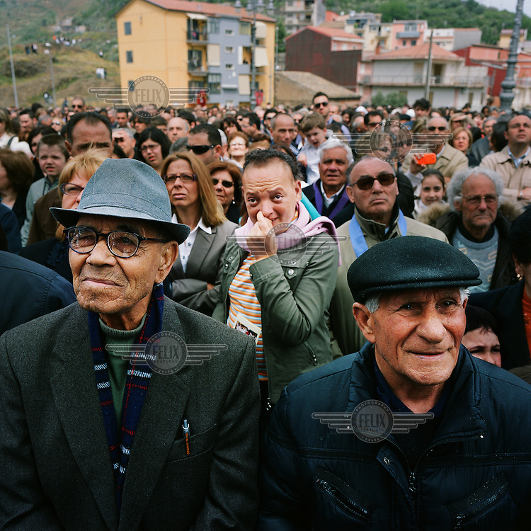 Parishioners watch the staged crucifixion of Jesus during an Easter service in Militello.