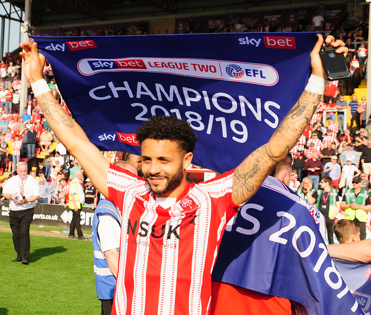 Lincoln City's Bruno Andrade celebrates securing the League 2 Title<br /> <br /> Photographer Andrew Vaughan/CameraSport<br /> <br /> The EFL Sky Bet League Two - Lincoln City v Tranmere Rovers - Monday 22nd April 2019 - Sincil Bank - Lincoln<br /> <br /> World Copyright © 2019 CameraSport. All rights reserved. 43 Linden Ave. Countesthorpe. Leicester. England. LE8 5PG - Tel: +44 (0) 116 277 4147 - admin@camerasport.com - www.camerasport.com