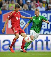 FUSSBALL   1. BUNDESLIGA   SAISON 2012/2013   LIGA TOTAL CUP  FC Bayern Muenchen - SV Werder Bremen       04.08.2012 Thomas Mueller (li, Bayern) gegen Aaron Hunt (re, SV Werder Bremen)