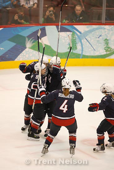 Trent Nelson  |  The Salt Lake Tribune.USA's Caitlin Cahow, Jocelyne Lamoureux, Karen Thatcher, Angela Ruggiero and Erika Lawler celebrate Thatcher's goal to put USA up 5-1. USA vs. Sweden, women's hockey, at the XXI Olympic Winter Games in Vancouver, Monday, February 22, 2010.