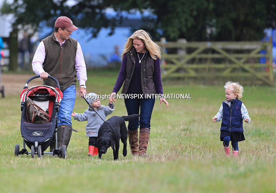 PETER AND AUTUMN PHILLIPS WITH DAUGHTERS SAVANNAH AND ISLA<br /> have a family day out at the Gatcombe Horse Trials, held on Princess Anne's home Gatcombe Park, Minchinhampton_21/09/2013.<br /> Mandatory Credit Photo: &copy;NEWSPIX INTERNATIONAL<br /> <br /> **ALL FEES PAYABLE TO: &quot;NEWSPIX INTERNATIONAL&quot;**<br /> <br /> IMMEDIATE CONFIRMATION OF USAGE REQUIRED:<br /> Newspix International, 31 Chinnery Hill, Bishop's Stortford, ENGLAND CM23 3PS<br /> Tel:+441279 324672  ; Fax: +441279656877<br /> Mobile:  07775681153<br /> e-mail: info@newspixinternational.co.uk