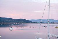 Sail boats docked in Talamone, Maremma district of Tuscany, Italy