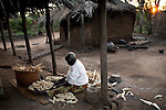 GALUFU, MALAWI NOVEMBER 11: An unidentified woman cleans maize husks outside her house on November 11, 2005 in Galufu, Malawi. She will use them for planting. Most people in the village are poor and hungry, and cannot afford to buy maize at the market as the price is twice as much as the government subsidized prices. The government used to sell subsidized maize and fertilizer but not anymore. Many people in the village eat mangoes and even boil unripe ones, as they cannot afford to buy anything else. The harvest was very bad in 2005 and the next one, due in April 2006 I uncertain because of lack of rains and drought. The village has seen an increase in poverty the last few years due to drought and HIV/Aids. Southern Africa has been hit by a severe hunger crisis due to drought and poverty. An ever-increasing HIV/Aids rate adds to the misery. Malawi is one of the worst hit areas and Galufu village is a typical small village that has become victim of this poverty spiral. (Photo by Per-Anders Pettersson)