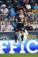 Gabriel Farfan (15) of the Philadelphia Union goes up for a header with Kei Kamara (23) of Sporting Kansas City. Sporting Kansas City defeated the Philadelphia Union 2-0 during the semifinals of the 2012 Lamar Hunt US Open Cup at PPL Park in Chester, PA, on July 11, 2012.