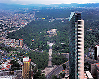 aerial photograph of Torre Mayor toward the monument to los Ninos Heroes and Chapultapec Castle and Chapultepec Park, Mexico City, Mexico.