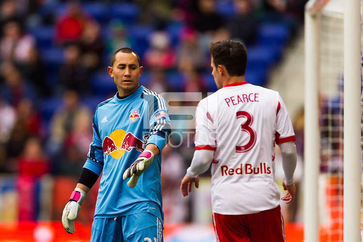 New York Red Bulls goalkeeper Luis Robles (31) talks with Heath Pearce (3). The New York Red Bulls and D. C. United played to a 0-0 tie during a Major League Soccer (MLS) match at Red Bull Arena in Harrison, NJ, on March 16, 2013.