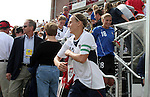 Kristine Lilly (13), leads her U.S. teammates, including Hope Solo (18) and Cat Reddick (4) onto the field before the game on Saturday, October 23rd, 2005 at Blackbaud Stadium in Charleston, South Carolina. The United States Women's National Team defeated Mexico 3-0 in an international women's friendly soccer match.